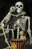 Halloween Skeletons getting ready to go trick or treating. Two Halloween Skeletons getting ready for the holiday royalty free stock photos