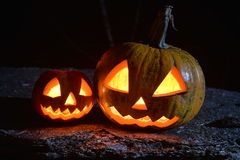 Two halloween spooky pumpkins. Under moonlight Royalty Free Stock Images