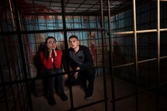 Two Halloween victims in a cage Stock Photography