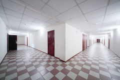 Two hallways with wooden doors Stock Photo