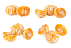 Two halves anh whole fresh juicy tangerine fruit isolated over the white background Stock Photos