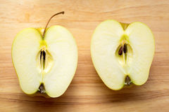 Two halves of an apple Stock Image