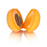 The two halves of apricot with reflection. Isolated on white background royalty free stock photography