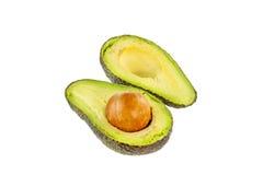 Two halves of avocado. Isolated on white background Royalty Free Stock Image