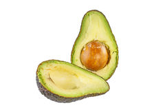 Two halves of avocado. Isolated on white. Two halves of avocado. Isolated on white background Stock Photography