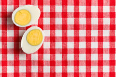 Two halves of a boiled egg Stock Photos