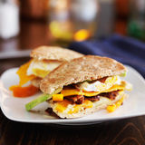Two halves of a breakfast sandwich on plate. Shot with selective focus Stock Image