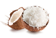 Two halves of coconut with coconuts flakes isolated on a white b. Ackground Royalty Free Stock Photos