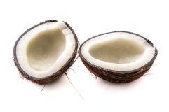 Two halves of coconut. Tropical fruits, coconuts on isolated white background stock image