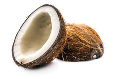 Two halves of coconut. Tropical fruits, coconuts on white background royalty free stock images