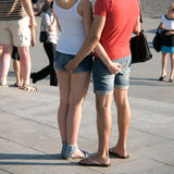 Falling in love squeeze each other per the buttock. Identification of reality. Falling in love in stylish jeans clothes squeeze each other per the buttock. In stock photography