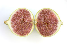 Two halves of fresh fig Stock Photos