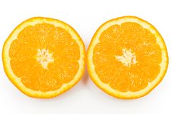 Two halves of an fresh orange on a white background. Two halves of an fresh juicy orange on a white background Royalty Free Stock Photos