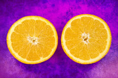 Two halves of fresh orange fruit Stock Images
