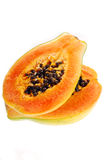 Two halves of fresh papaya isolated on white Stock Photo