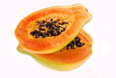 Two halves of fresh papaya isolated on white Royalty Free Stock Images