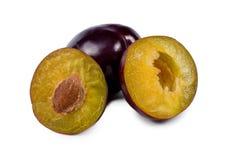 Two halves of a fresh purple plum Stock Photos