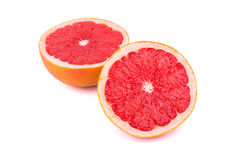 Two halves of a grapefruit. Two halves cut grapefruit on a white background Royalty Free Stock Images
