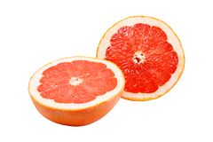 Two halves of grapefruit on white background royalty free stock photos