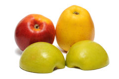 Two halves of green apple, yellow and red apples Stock Photo