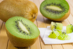 Two halves of green kiwi and whole kiwi, kiwi Stock Images