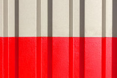 The two halves grey and red of the figure of corrugated texture. Concept: reliable, abstract, creative, art, fence stock photo