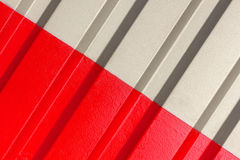 The two halves grey and red of the figure of corrugated texture. Concept: reliable, abstract, creative, art, fence royalty free stock image