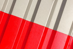 The two halves grey and red of the figure of corrugated texture. Concept: reliable, abstract, creative, art, fence stock images