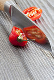 Two halves of a habanero chili pepper Royalty Free Stock Images
