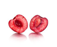 The two halves of juicy cherries Stock Images