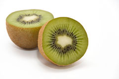 Two halves of kiwi Stock Images