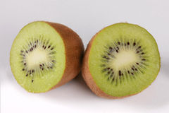 Two halves of a kiwi fruit on a white background Stock Images