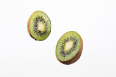 Two halves of kiwi and on white background. Two halves of kiwi and on white background Royalty Free Stock Images