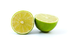 Two halves of lime. Isolated on the white background Royalty Free Stock Photos