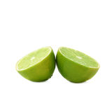 Two halves of a lime fruit isolated over the white Royalty Free Stock Photos