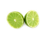 Two halves of a lime fruit isolated over the white Stock Photo