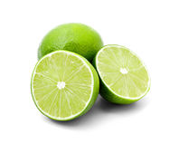 Two halves of lime and one whole lime Stock Images