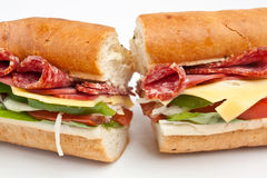 Two halves of long baguette sandwich Royalty Free Stock Image