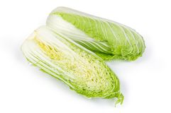Two halves of napa cabbage head on a white background. Two halves of head napa cabbage also known as chinese cabbage, cut along on a white background royalty free stock images