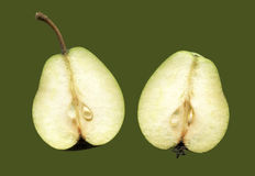 Two halves of one fruit pears  on a green background. Stock Photo