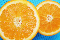 Two halves of orange. An orange cut into two halves stock photo