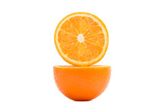 Two halves of an orange in a cut. Pulp of orange on white background. Orange on a white background stock image