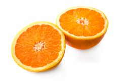 Two halves of orange. S on white background stock photo