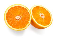 Two halves of orange. S on white background royalty free stock photo