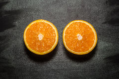 Two halves of an orange. On the plate Stock Image