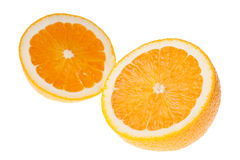 Two halves of orange. Slightly ovelapping royalty free stock images