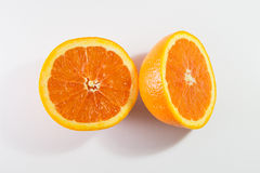 Two halves orange. On a white royalty free stock image