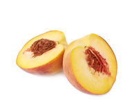 Two halves of a peach fruit isolated Stock Images