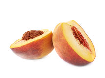 Two halves of a peach fruit isolated Royalty Free Stock Photography