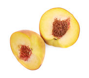 Two halves of a peach fruit isolated Stock Photo